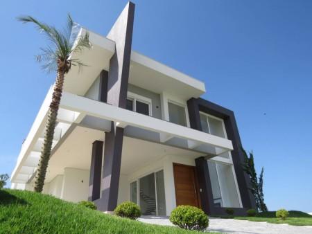 Casa em Condomínio 4 dormitórios em Capão da Canoa   Ref.: 8663